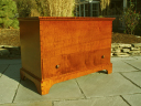 Tiger maple blanket chest finished in Golden Amber aniline dye.