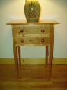 Cherry side table with natural finish.