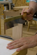 Cutting the tails with a dovetail saw