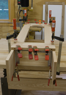 Waist sides are glued to the face frame with tung and grove joinery.